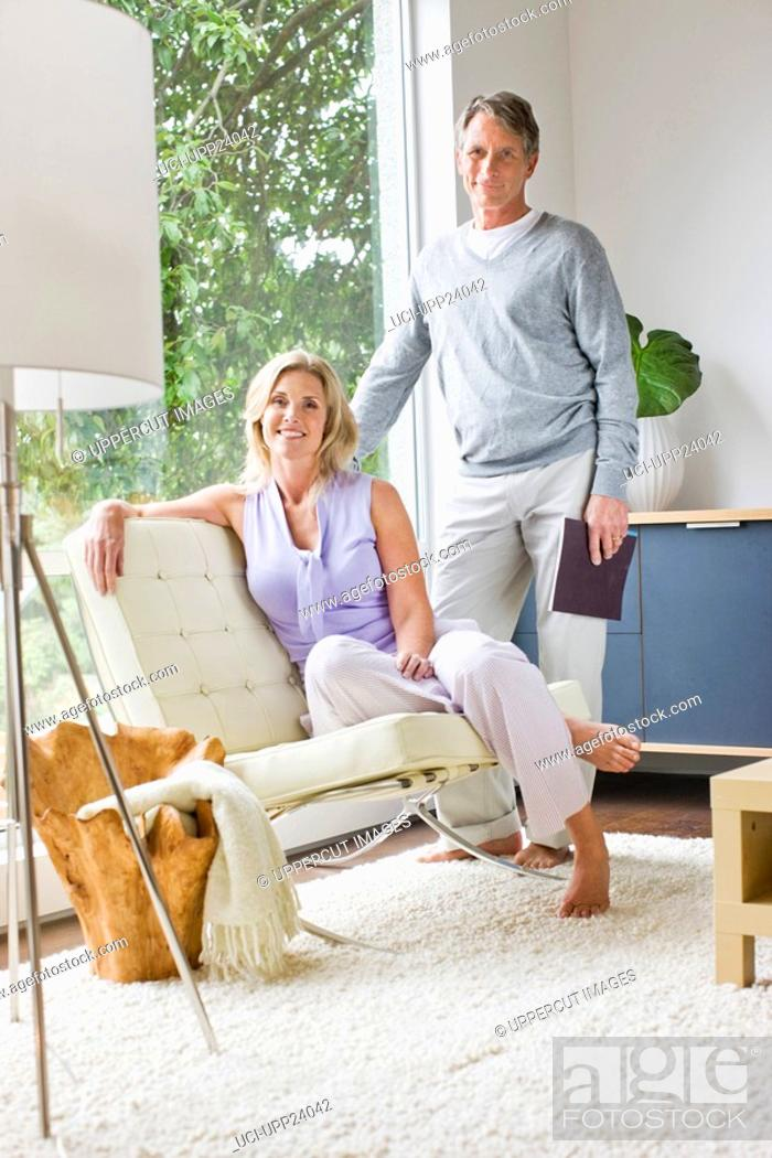 Stock Photo: Portrait of couple in living room.