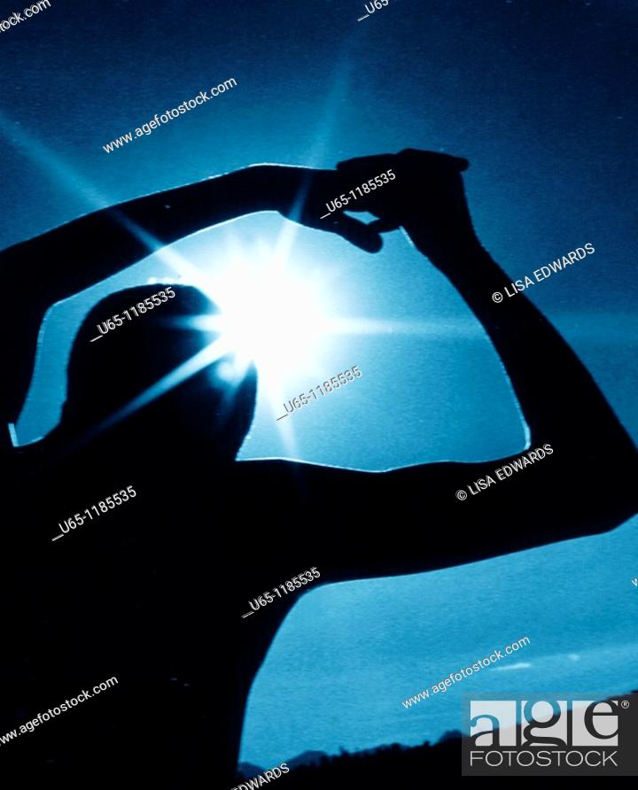 Stock Photo: Boy with sun in his arms.