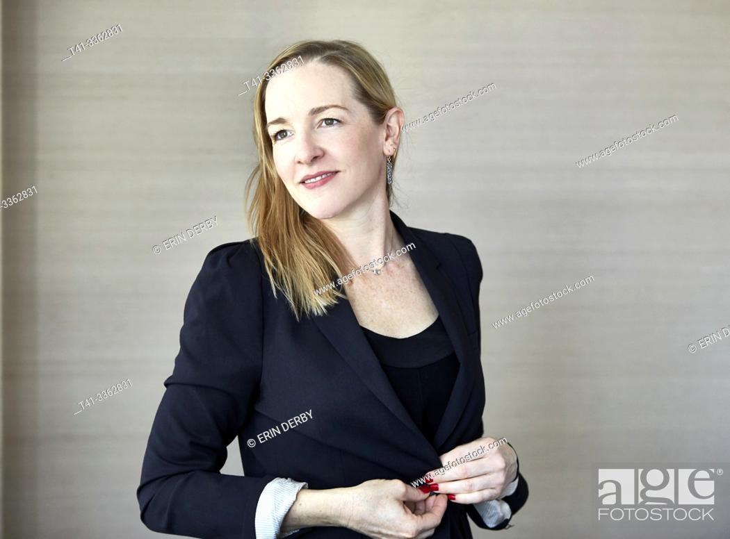 Stock Photo: Woman in office wearing blazer.