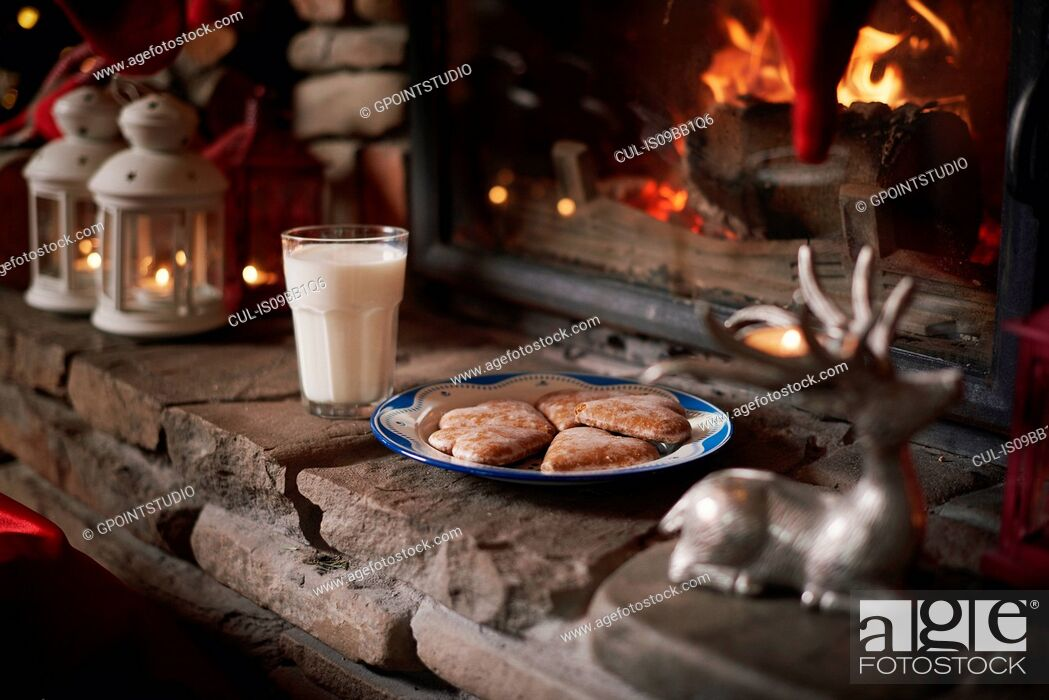 Stock Photo: Cookies and milk, for Santa, left beside fireplace.