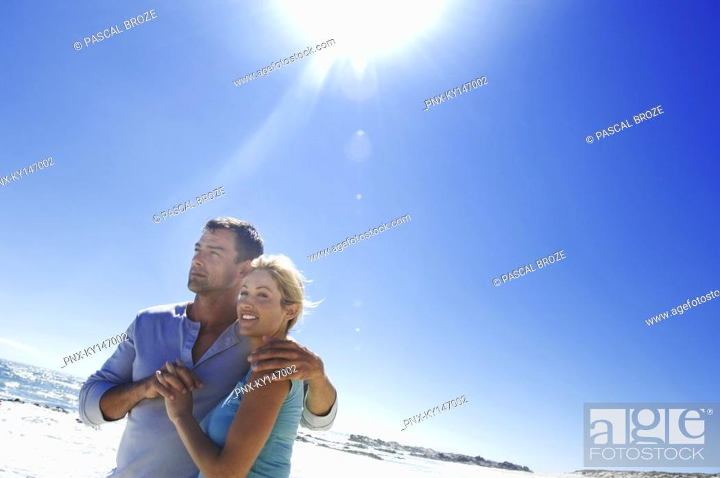 Stock Photo: Couple embracing on the beach.