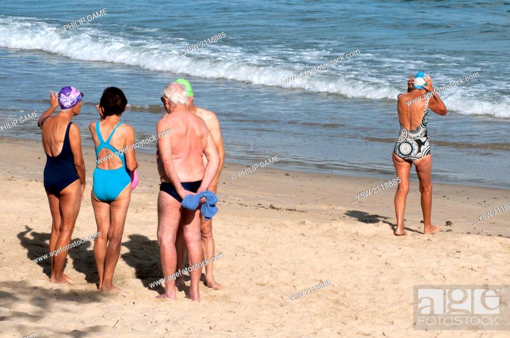 Stock Photo: Going it alone: seniors on the beach at Mooloolaba, Sunshine Coast, Queensland, Australia.