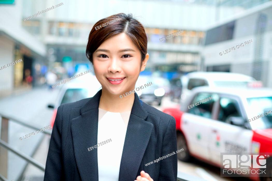 Stock Photo: Businesswoman standing at outdoor.