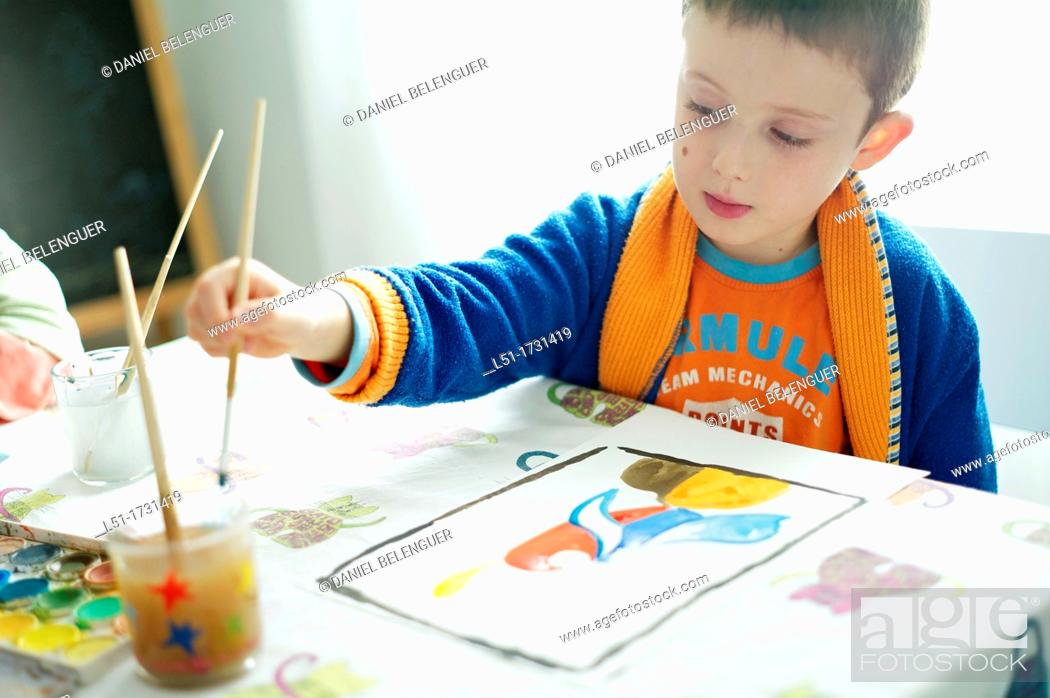 Stock Photo: Children painting watercolor, Valencia, Spain.