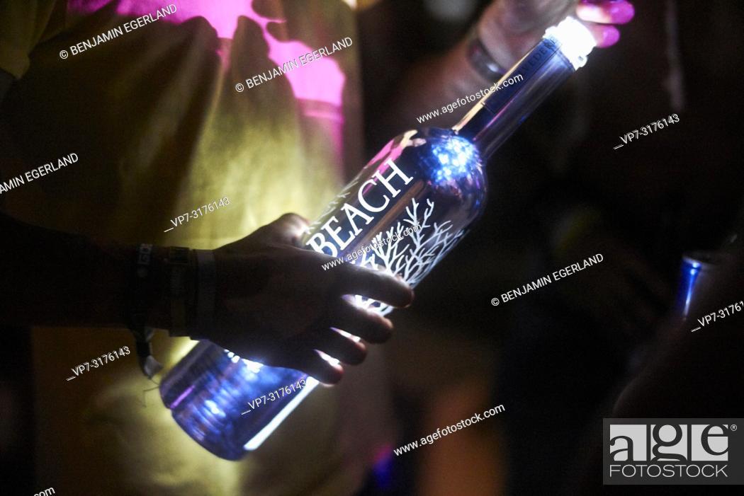 Stock Photo: hand holding Belvedere Vodka bottle at music festival Starbeach Chersonissos, Crete, Greece, at 06. August 2018.