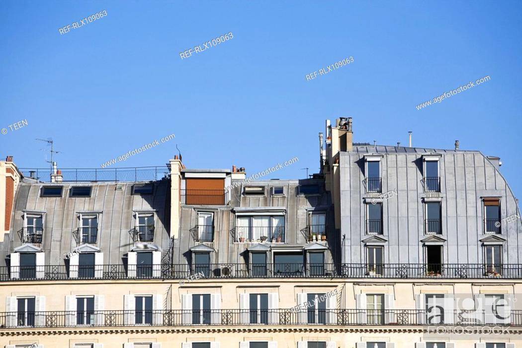 Stock Photo: Rooftop facade of apartment houses, Paris, France.