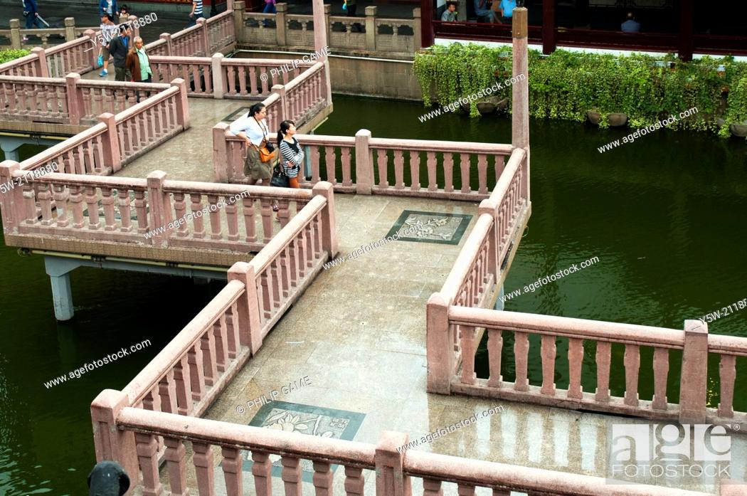 Stock Photo: Zigzagging bridge crosses an ornamental lake at the Yu Bazaar, Shanghai, China. There is free access to this area, which is not a paid attraction.