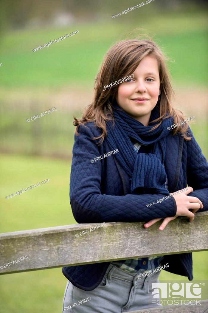 Stock Photo: Portrait of a girl smiling in a farm.