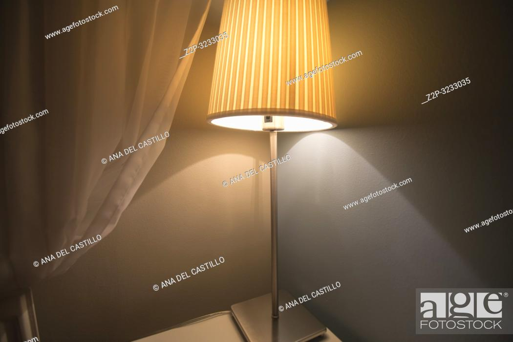 Imagen: . Interior of room with courtain and lamp grey background.