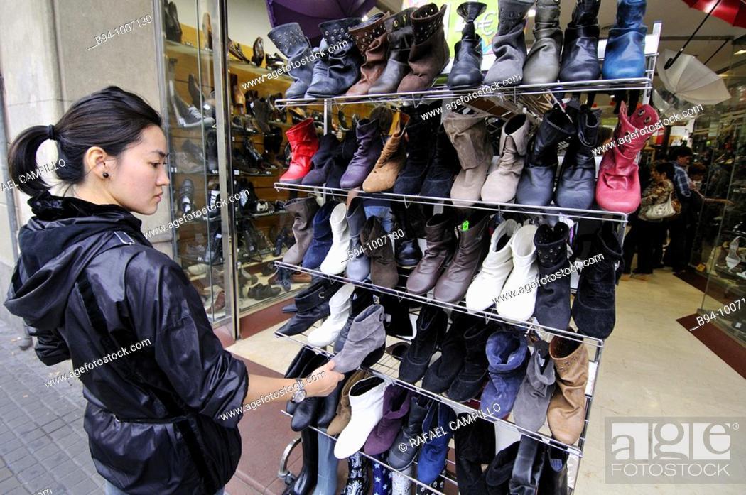 eb15b1fde7123 Stock Photo - Woman in a shoe shop