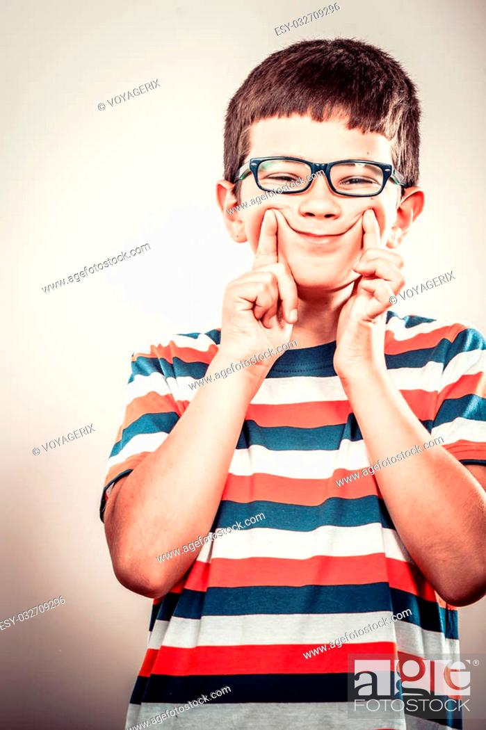 Stock Photo: Crazy kid little boy making silly face expression. Childhood fun.