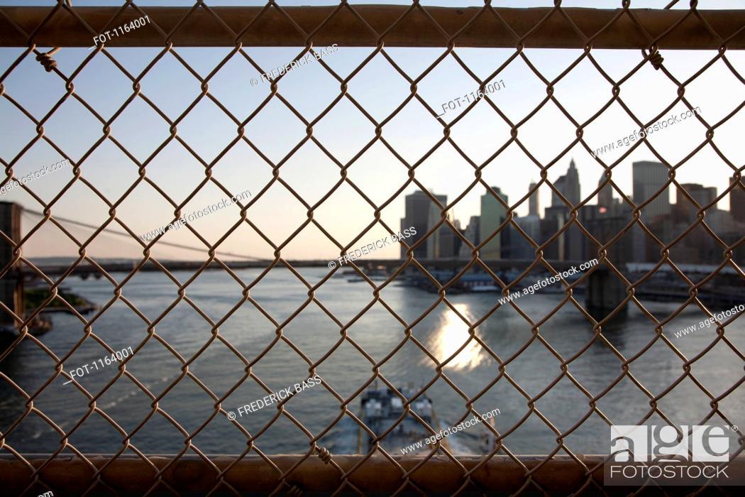 Stock Photo: Bridge wire mesh fence.