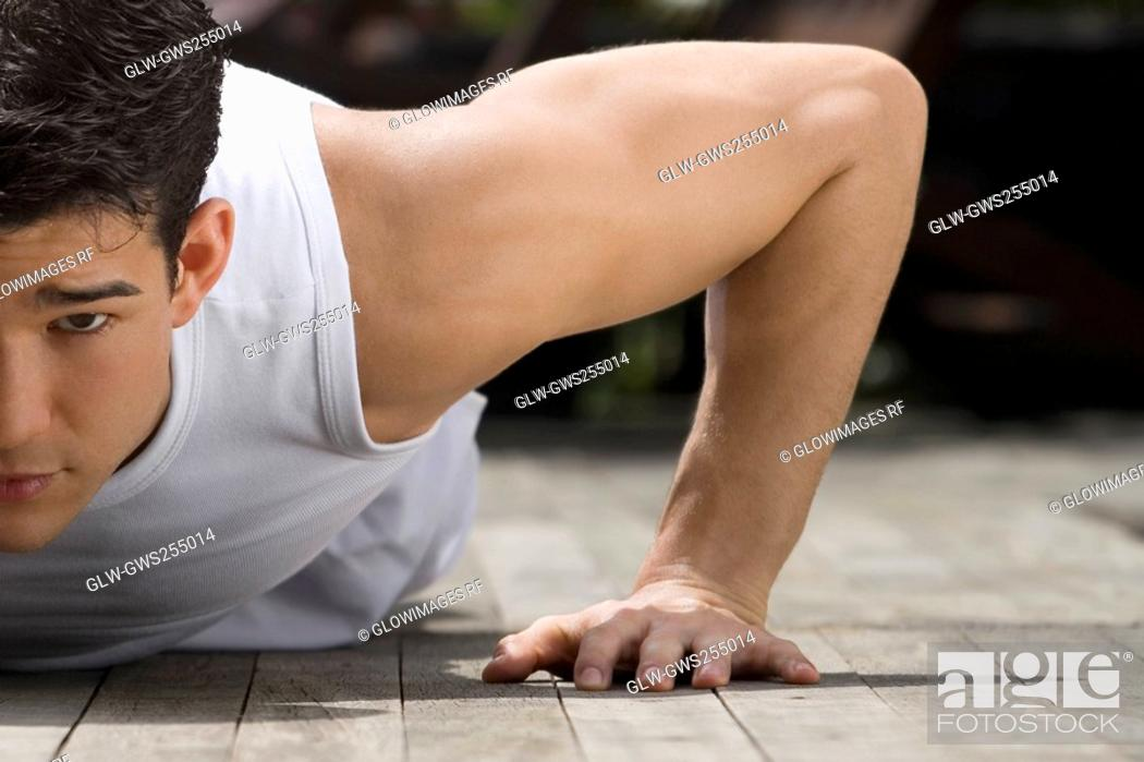 Stock Photo: Close-up of a young man doing push-ups.