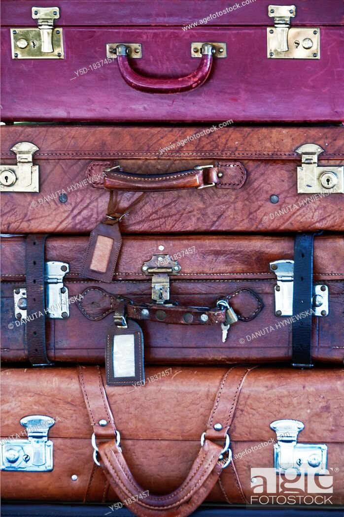 Stock Photo: old leather suitcases laying in a stock one on another.