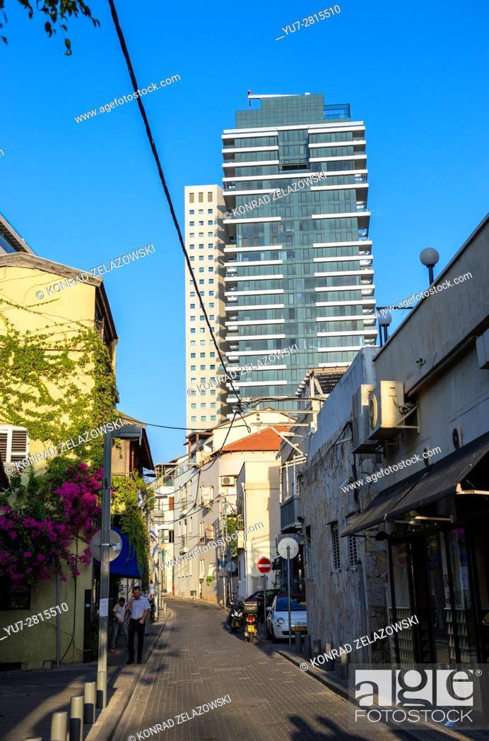 Stock Photo: Shalom Shabazi street in Neve Tzedek neighborhood, Tel Aviv city, Israel. 1 Rothschild Boulevard Tower on background.