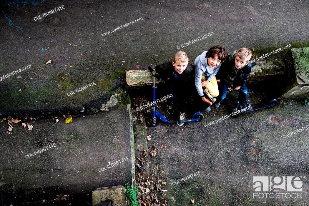 Stock Photo: Boys looking up from ground level.