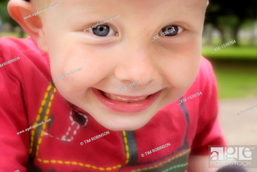 Stock Photo: Close up face 4 year boy smiling widely.