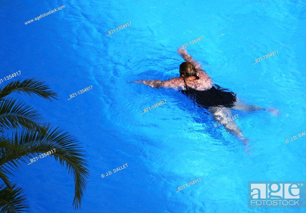 Stock Photo: Obese woman swimming.