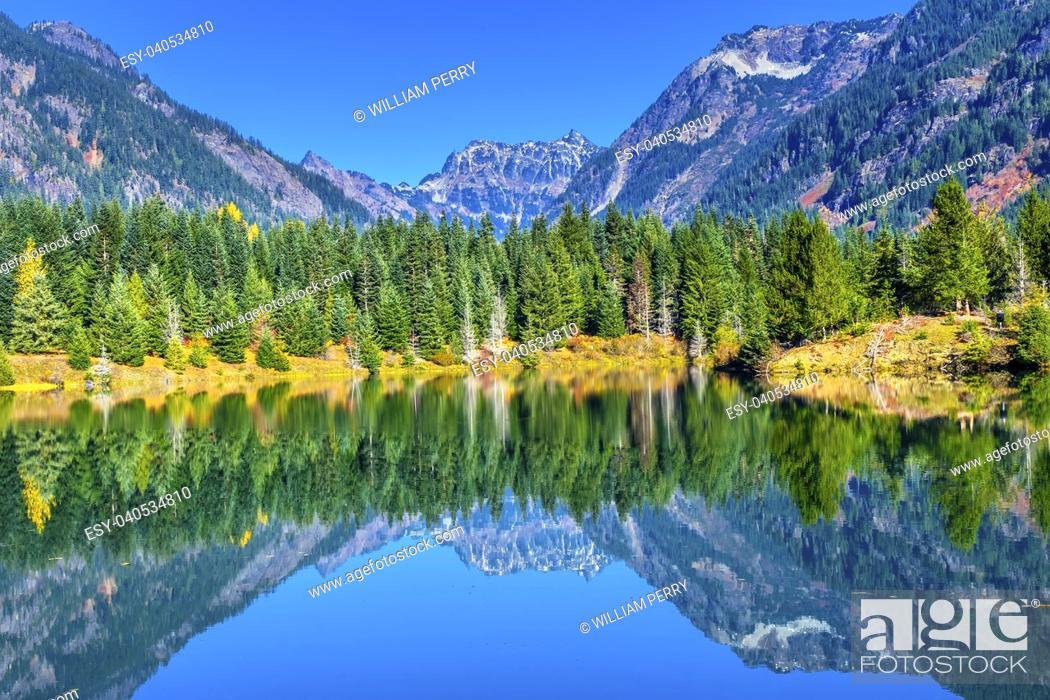 Stock Photo: Gold Lake Reflection Mount Chikamin Peak Fall Snoqualme Pass Wenatchee National Forest Wilderness Washington.