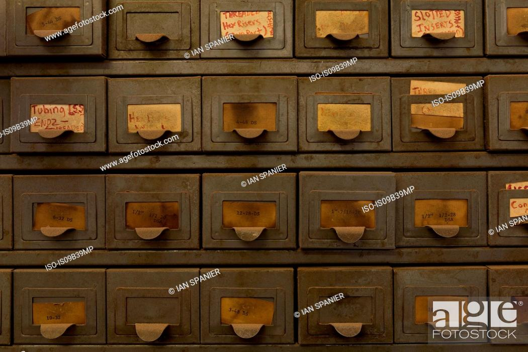 Stock Photo: Labelled drawers.