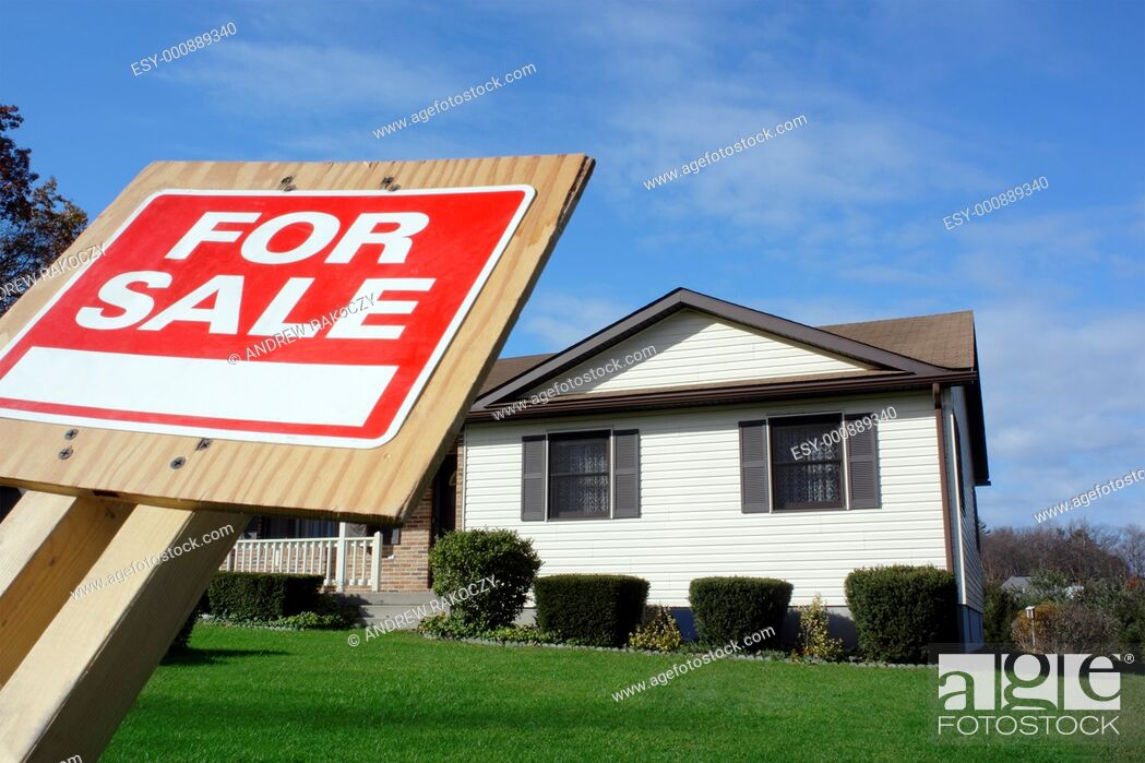 Stock Photo: House with For Sale Sign Focus on For Sale Sign.
