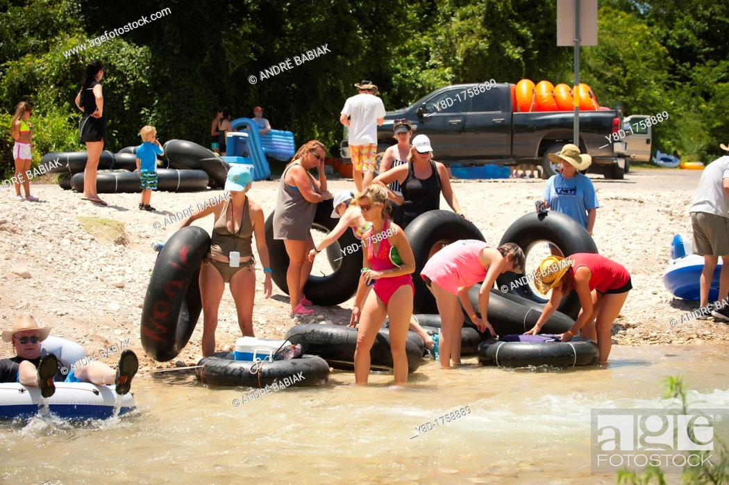 Stock Photo: Tourists preparing for river tubing at the Frio River near Concan, Texas, USA.
