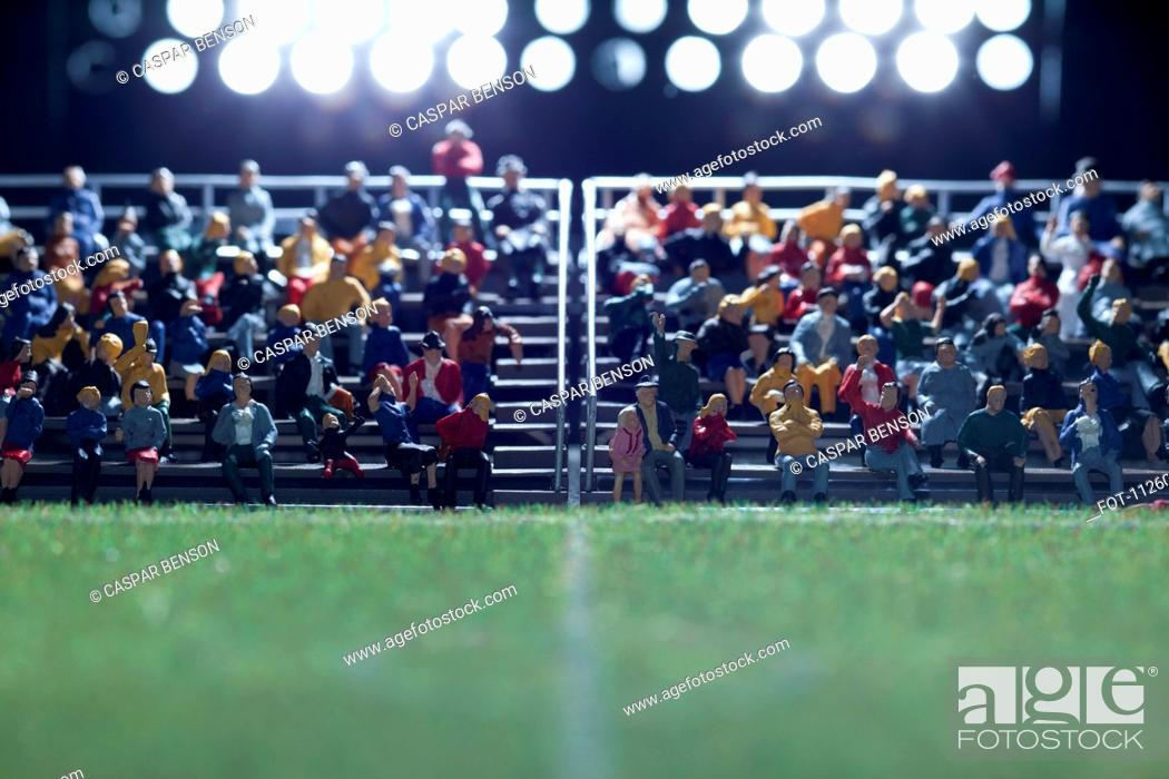 Stock Photo: The center field of a miniature soccer field, spectator figurines in background.