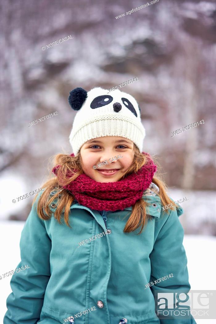 Photo de stock: Portrait of smiling girl outdoors in winter.