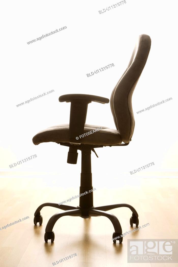 Stock Photo: Still life of empty office desk chair.
