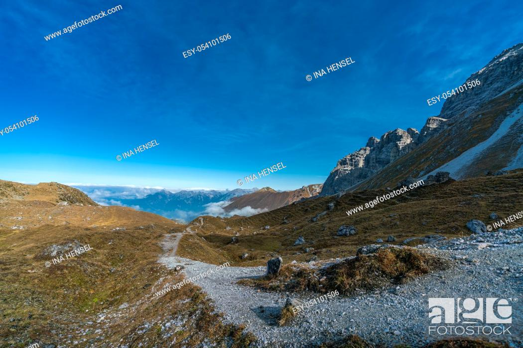 Stock Photo: Overlooking the Senders valley to the Innsbruck mountains Inntalkette from Kemater Alm.
