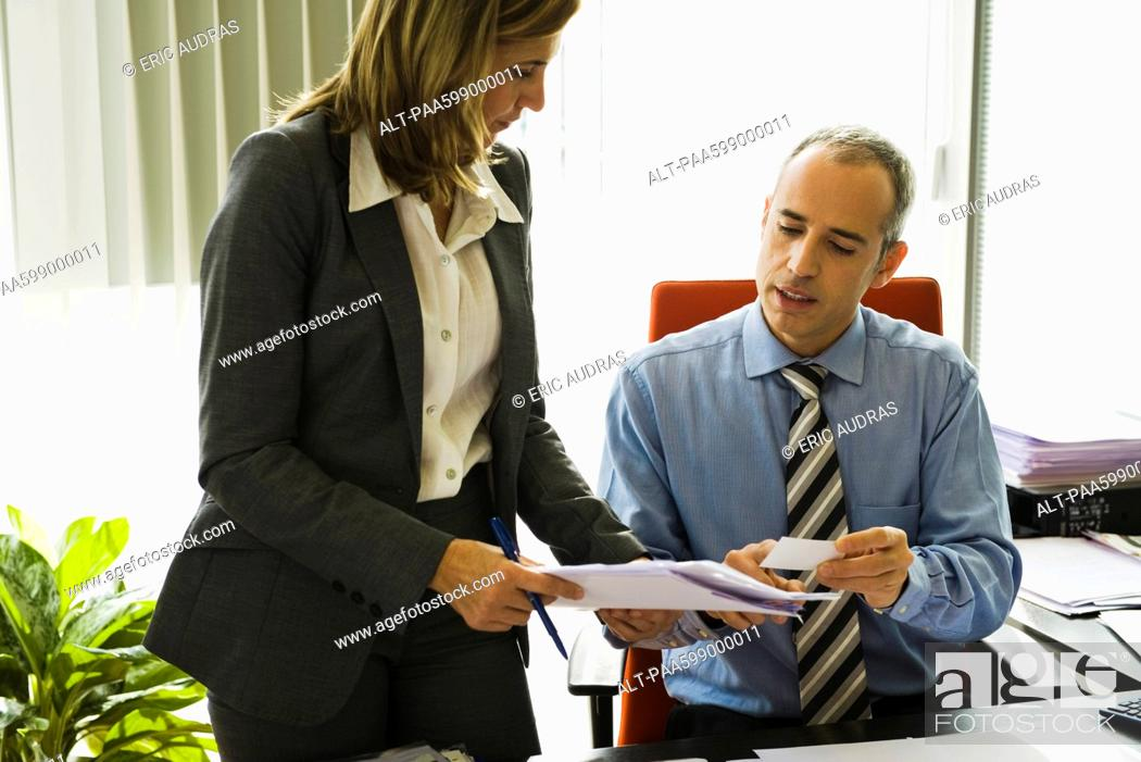 Stock Photo: Businessman talking to colleague.