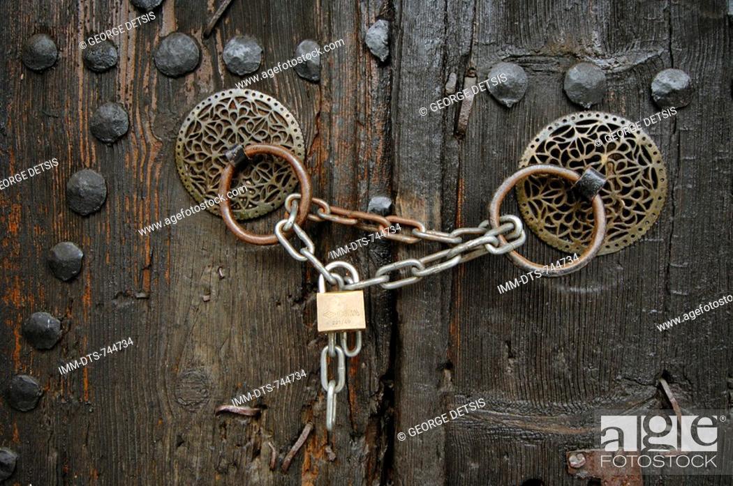 Stock Photo: Locked door handles. Monodendri, Zagorohoria, Ioannina, Greece, Europe.