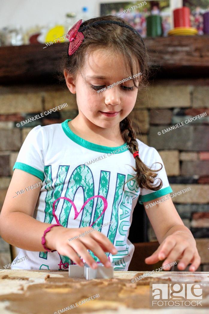 Stock Photo: Children prepare cookies in the kitchen.