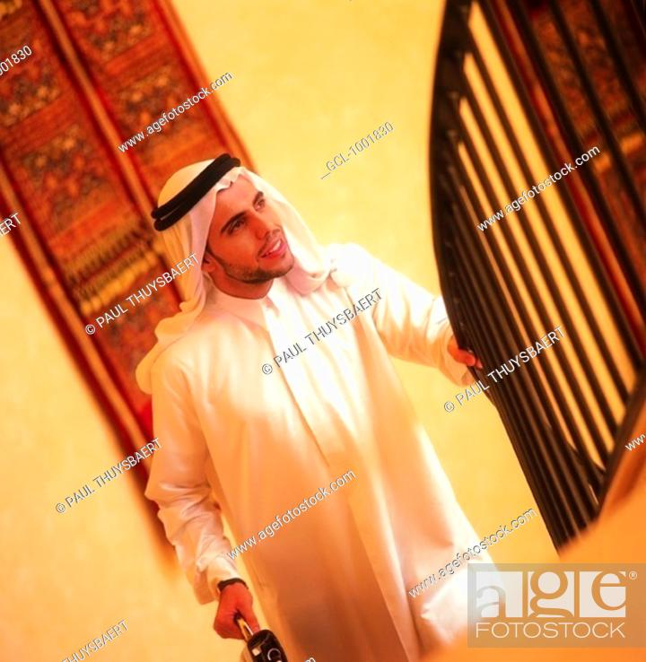Stock Photo: Arab businessman walking up stairs.