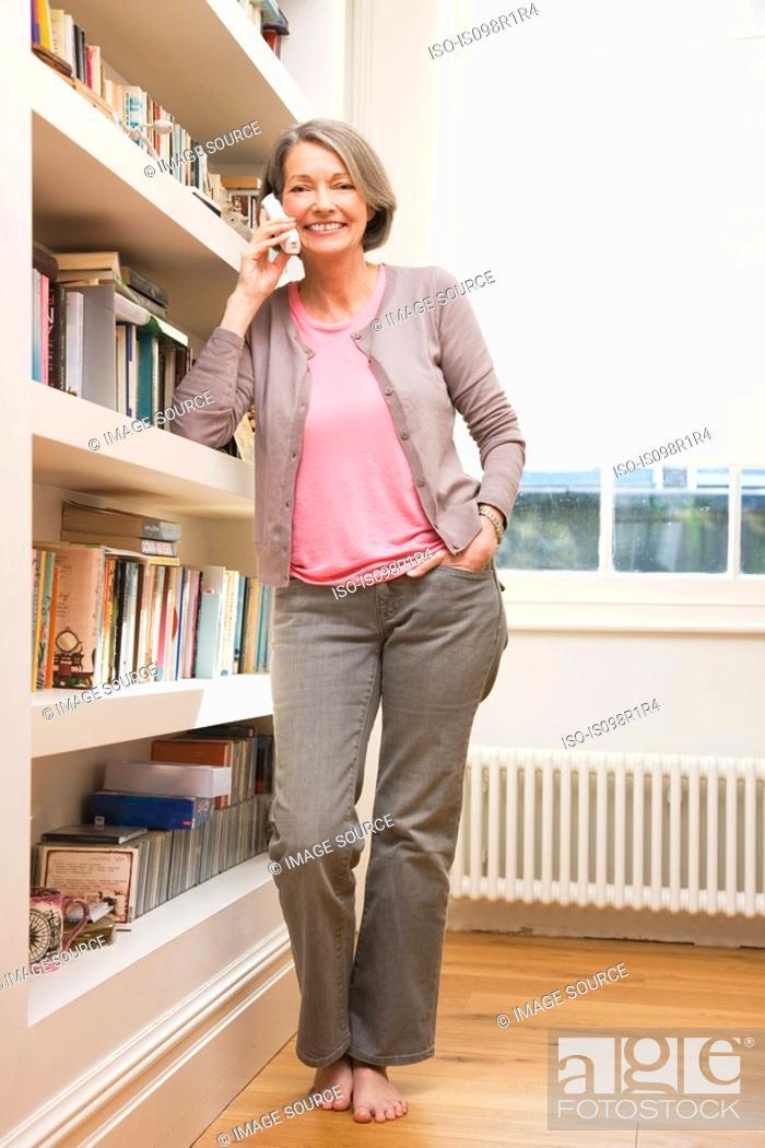 Stock Photo: Mature woman using telephone.