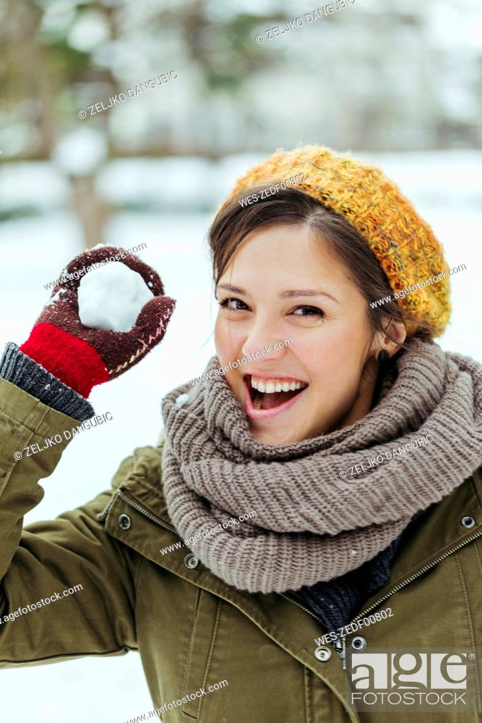 Photo de stock: Portrait of laughing woman holding snowball.