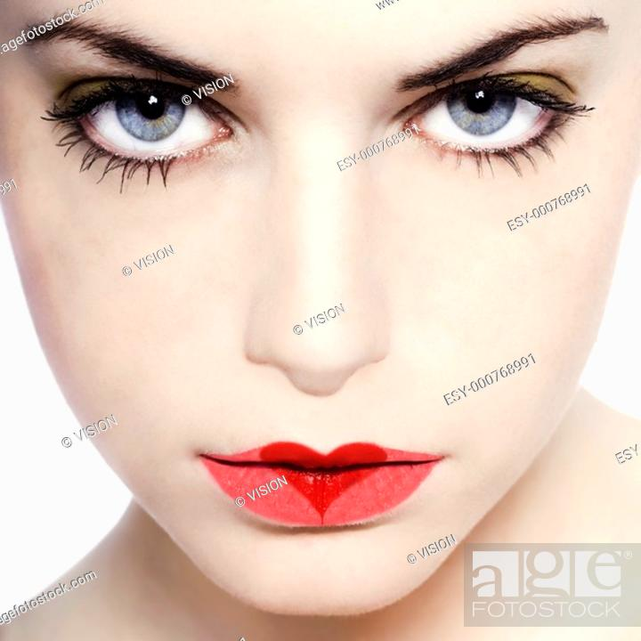 Stock Photo: young beautiful caucasian woman playing with heart drawing on lips.