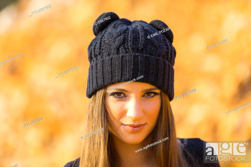 a40220a1ebba Stock Photo - Young woman with wool cap