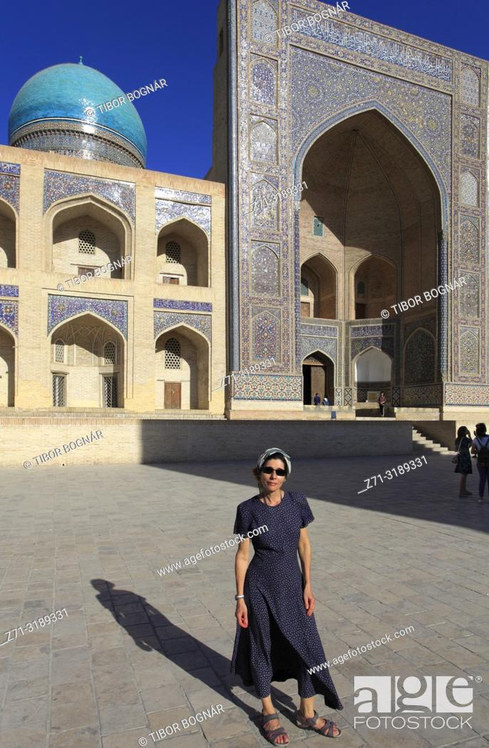 Stock Photo: Uzbekistan; Bukhara; Mir-i-Arab Madrasa, islamic school, western tourist,.