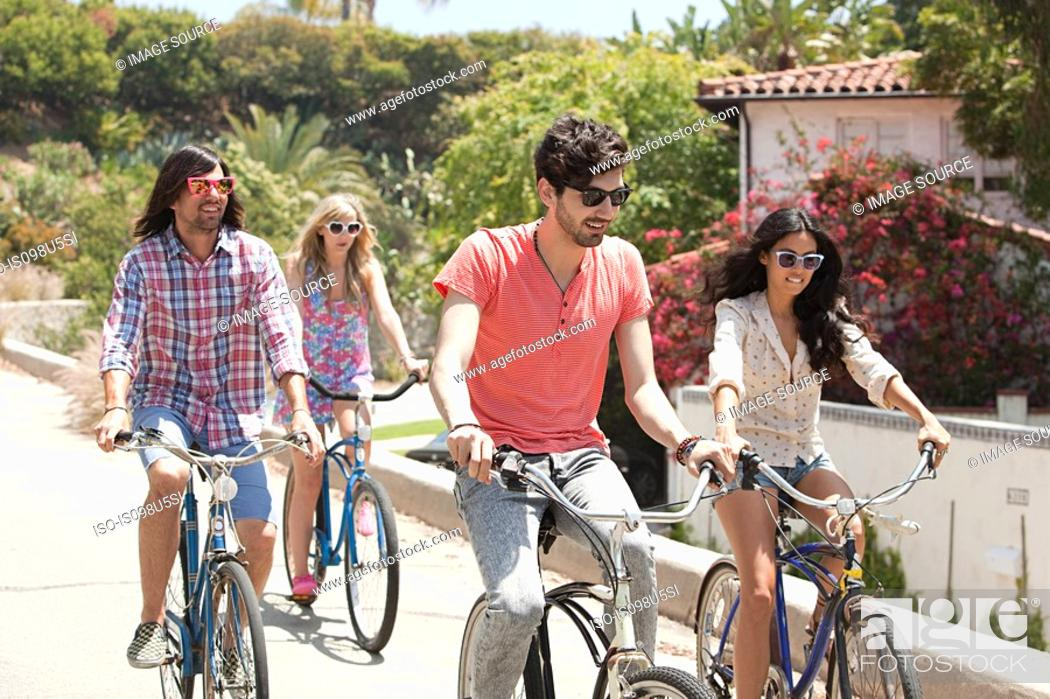 Imagen: Young friends on bicycles on vacation.