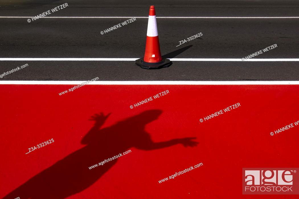Stock Photo: Brand new bicycle and pedestrian road with shadow of a woman in Las Palmas de Gran Canaria, Canary Islands.