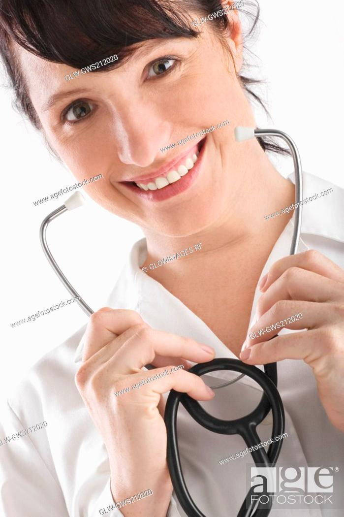 Stock Photo: Portrait of a female doctor holding a stethoscope.