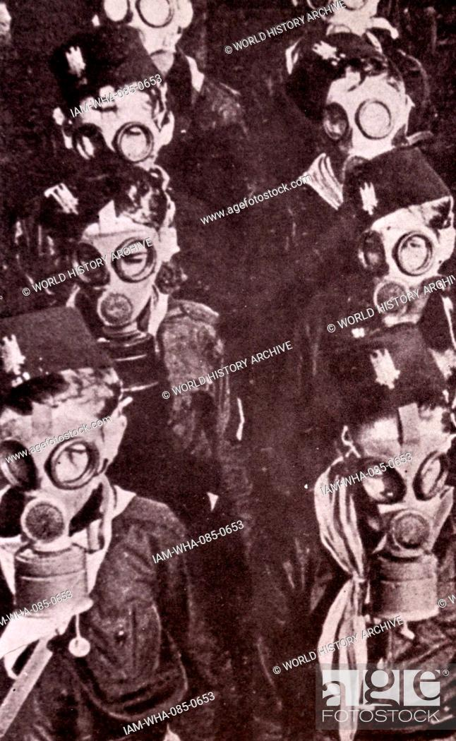 Stock Photo: Photograph of Italian Fascist Youths of the Balillas wearing gas masks. Dated 20th Century.