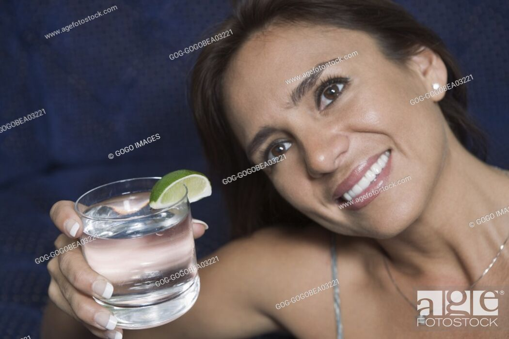 Stock Photo: Woman raising her glass in toast.