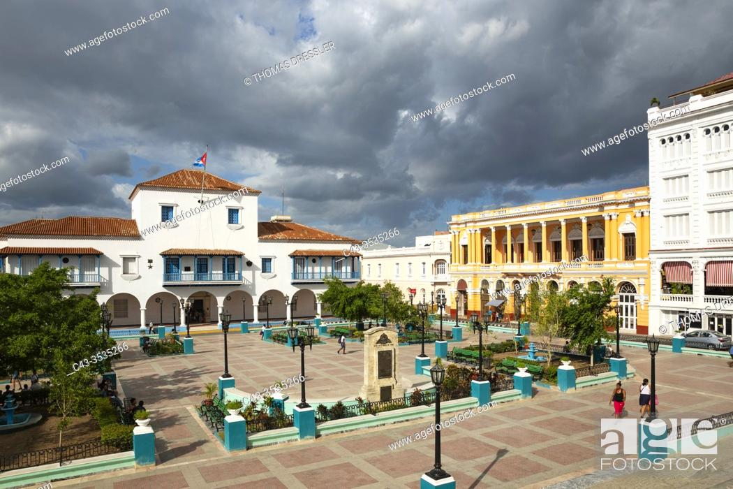 Stock Photo: Parque Céspedes with the town hall on the left and the splendid nineteenth-century building of the Casa de la Cultura on the right.