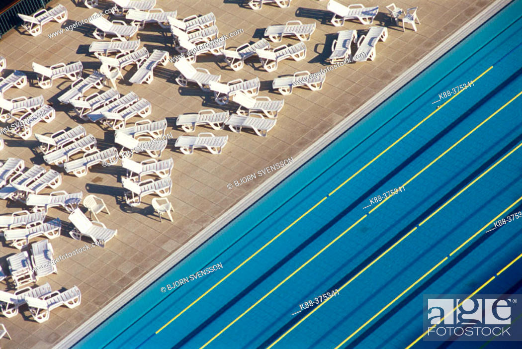 Stock Photo: Swimming pool and deck chairs. Barcelona. Spain.