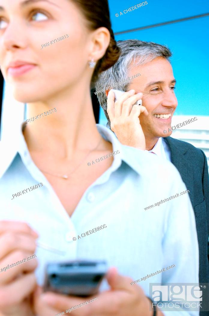 Stock Photo: Business people using mobile phones.