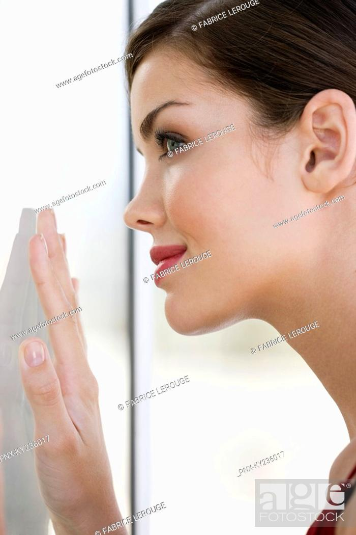 Stock Photo: Close-up of a fashion model looking at her reflection.