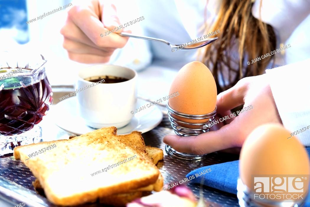 Stock Photo: Breakfast in bed in hotel. Redhead gird after taking shower peels boiled egg in bed in hotel room.
