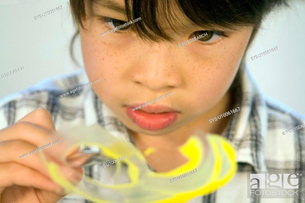 Stock Photo: Portrait of Asian kid painting.